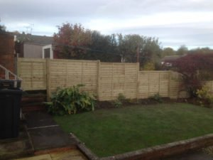 Birstall Tree Services Fence and garden after our intervention